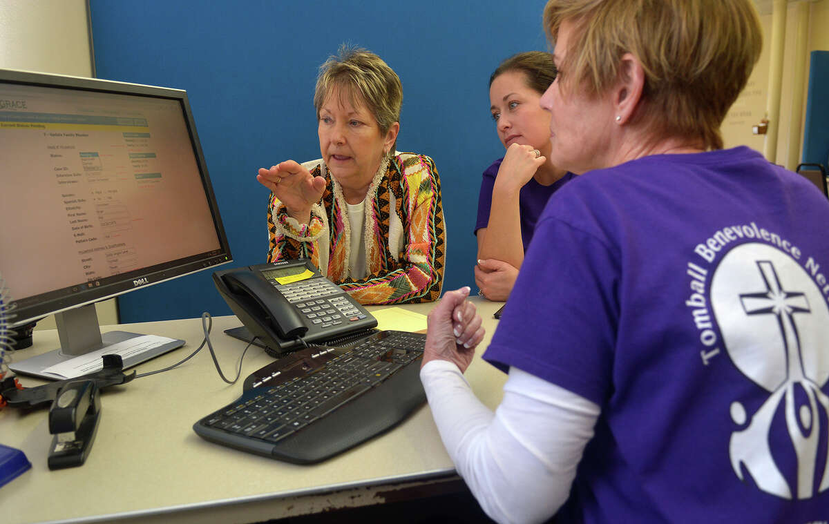 Becky Loving, from left, Tomball Emergency Assistance Miistries Director, Jessica Quirin, a TEAM case worker, and Susan Schaeper, Tomball Benevolence Network (TBN) Manager, go over their management system (GRACE), a new computer resource iCLoud program, at the TEAM ministry office in downtown Tomball on Jan. 10, 2017. (Photo by Jerry Baker/Freelance)