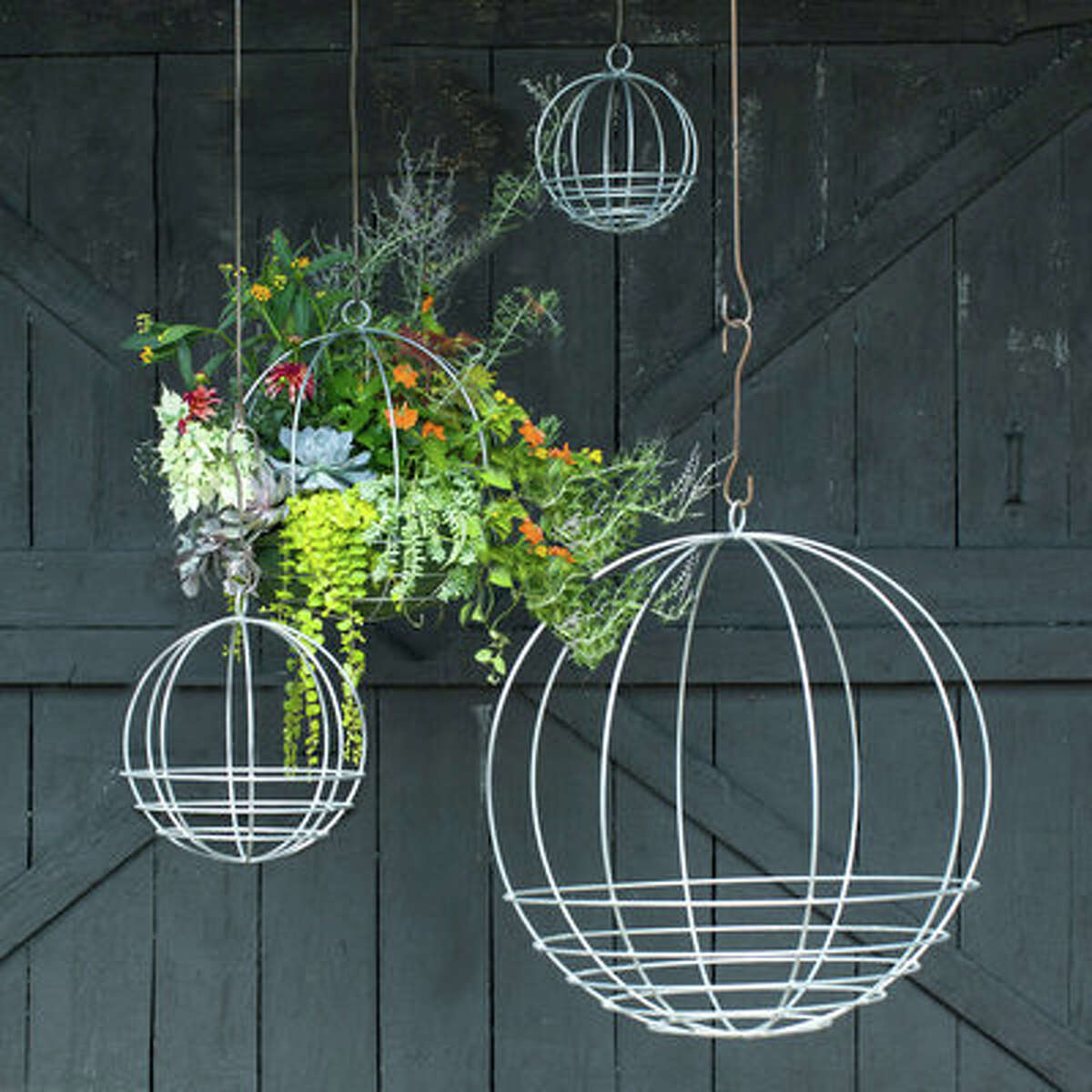 Hanging around the Yard Zinc Sphere Hanging Basket, available in four sizes, from small to extra-large, from $38 Add whimsy to your outdoor spaces with artful hanging baskets. Made in California exclusively for Terrain, these dangling planters are the perfect vessel for your brightest and boldest springtime buds. Each basket can also be paired with Terrain's basket liners, which makes for easy planting.
