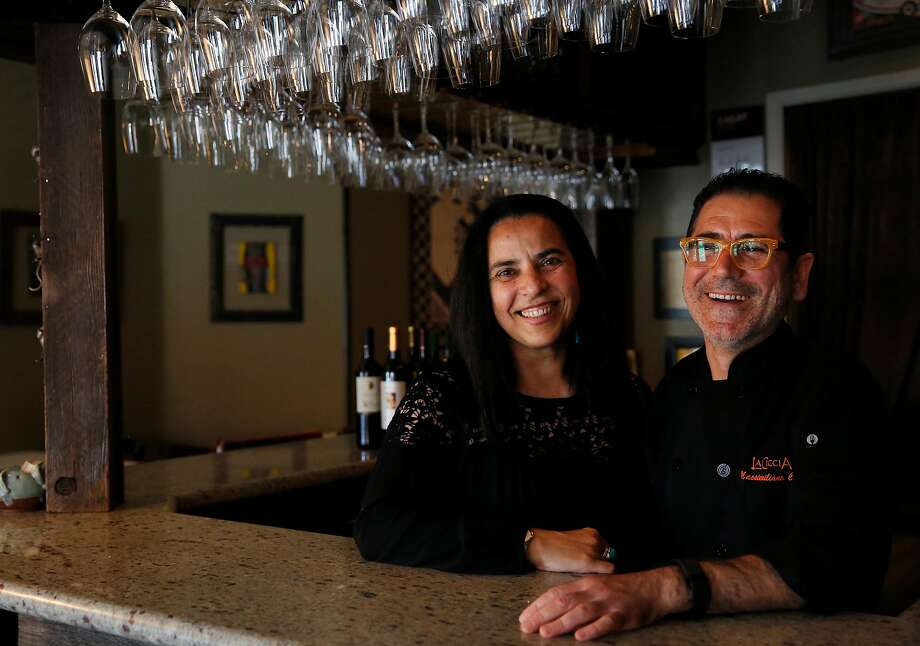 Owners Massimiliano Conti, right, and Lorella Degan pictured at their restaurant La Ciccia May 26, 2017 in San Francisco, Calif. Photo: Leah Millis, The Chronicle