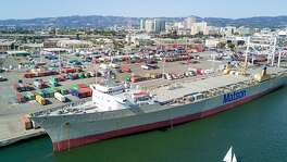 A ship docks at the Howard Terminal, one of the sites under consideration for a new Oakland Athletics baseball stadium, on Saturday, May 27, 2017, in Oakland, Calif.