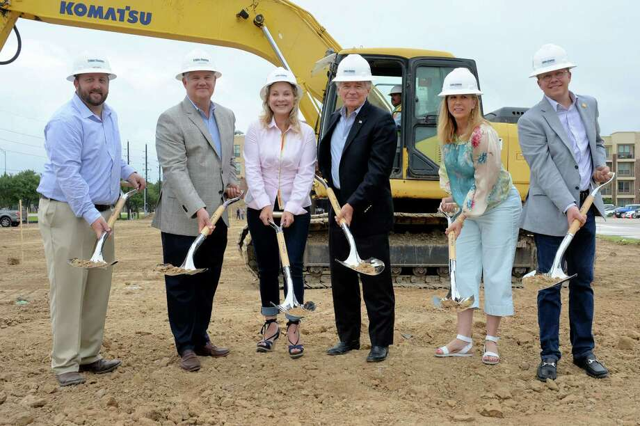 Representatives from The Vista Companies, Triple Tap Ventures and Tribble & Stephens break ground Friday on the final phase of development at LaCenterra at Cinco Ranch in Katy.  Pictured are (from left): Lance Smith, VP of Operations of Tribble & Stephens Construction; Van Martin, Chairman and CEO of Tribble & Stephens Construction; Dana Garnett, Sr. VP of Development of Vista Equities Group; Woody Mann, President of Vista Equities Group; Donna Keith, Vice President of Leasing of Vista Equities Group; and Neil Billingsley-Michaelsen, President and CEO of Triple Tap Ventures LLC. Photo: Craig Moseley, Staff / ©2017 Houston Chronicle