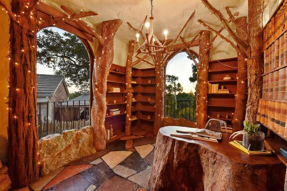 The unique study at 4420 Bridgeview Drive in Oakland includes living trees and a built-in redwood desk.�