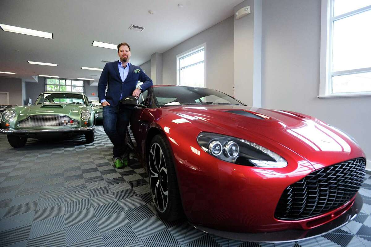 Matthew Ivanhoe, president of the Cultivated Collector, next to a 2012 Aston Martin V12 Vantage Zagato inside his Vitti Street showroom and club in New Canaan on Thursday. Only 64 2012 Aston Martin V12 Vantage Zagatos were made.