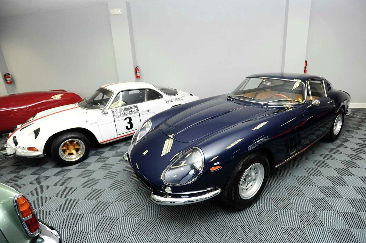 A dark blue 1967 275 GTB/4 Ferrari sits inside the Cultivated Collector showroom and club in New Canaan, Conn. on Thursday, May 25, 2017.