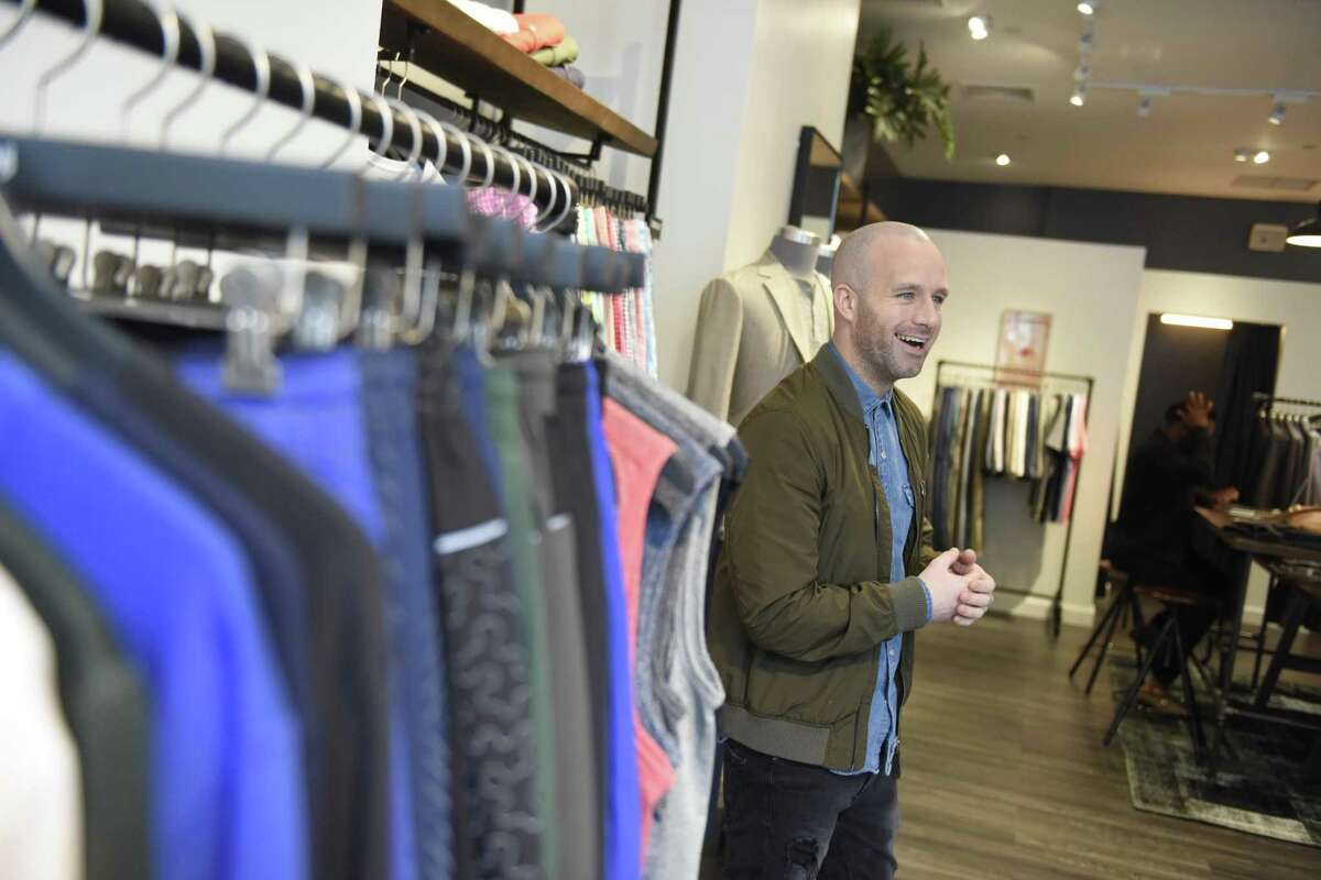 """Guideshop Manager Mike Gratton shows clothing items at the new Bonobos """"Guideshop"""" store on Greenwich Avenue."""