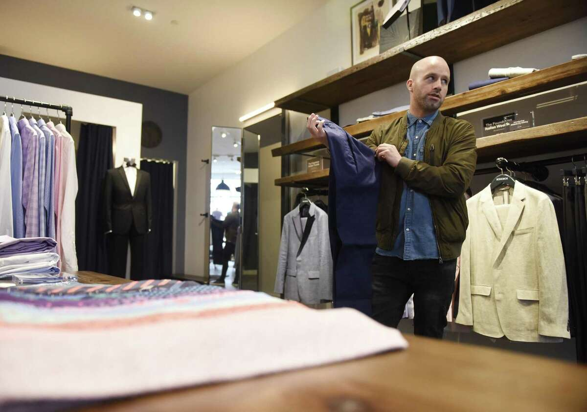 """Manager Mike Gratton shows clothing items at the new Bonobos """"Guideshop"""" store on Greenwich Avenue on Tuesday."""
