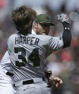 Washington Nationals' Bryce Harper (34) charges San Francisco Giants' Hunter Strickland after being hit with a pitch in the eighth inning of a baseball game Monday, May 29, 2017, in San Francisco. (AP Photo/Ben Margot)