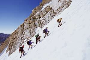 Mountaineers climbing up Mount Whitney near Lone pine, California, USA