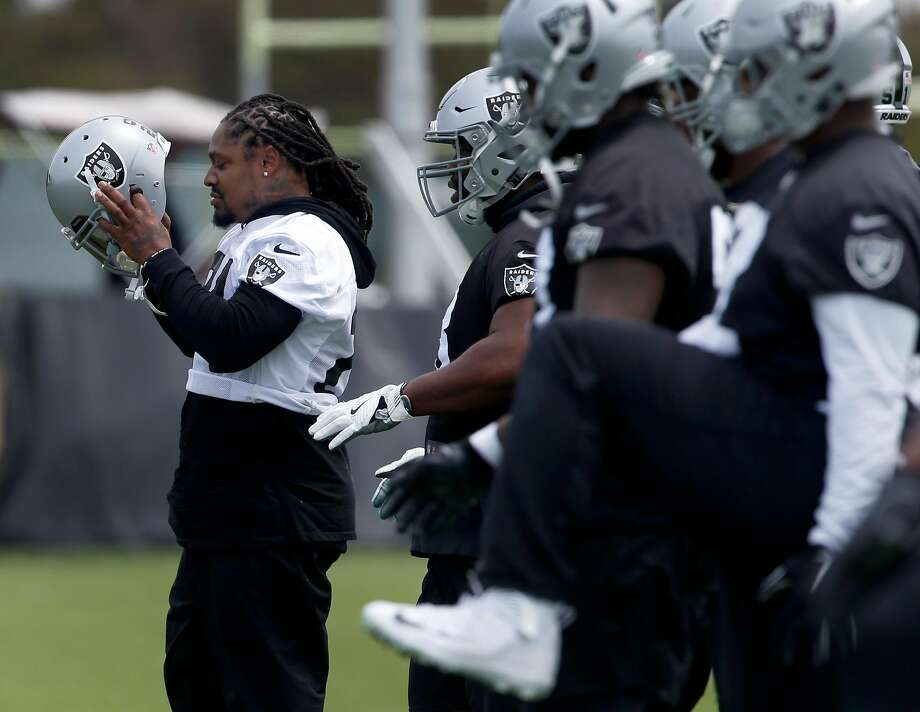 Former Cal and Seattle Seahawks running back Marshawn Lynch plays a maddening cat-and-mouse game with the media while remaining engaged in his home community. Photo: Paul Chinn, The Chronicle