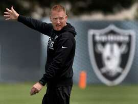 Offensive Coordinator Todd Downing runs a passing drill at an Oakland Raiders team practice in Alameda, Calif. on Tuesday, May 30, 2017.