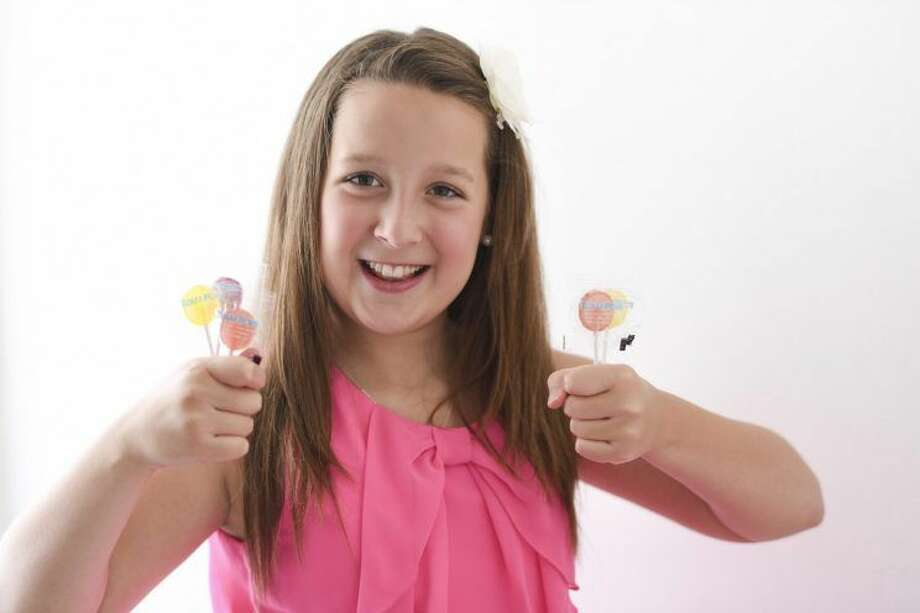 """12-year-oldAlina Morse is founder/inventor ofZollipops(aka the """"clean teeth lollipops""""). Photo: Zollipops.com"""