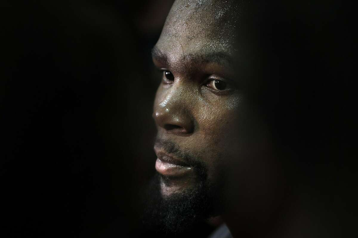 Kevin Durant talks to reporters during practice at the Warriors headquarters in Oakland, Calif., on Tuesday, May 30, 2017.