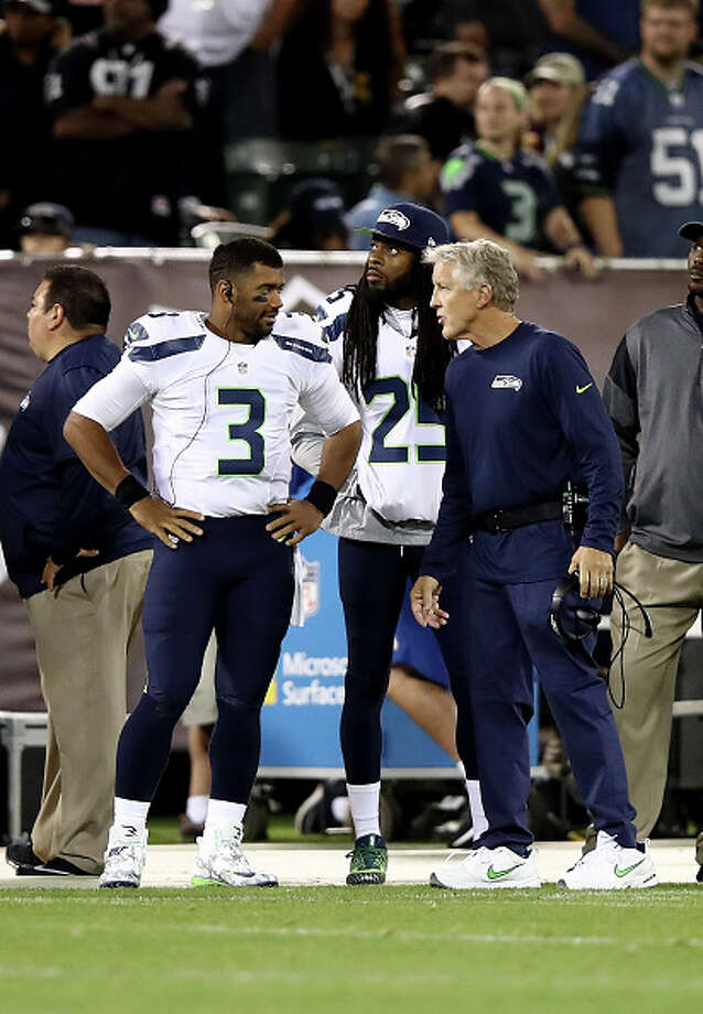 OAKLAND, CA - SEPTEMBER 01:  Head coach Pete Carroll of the Seattle Seahawks talks to Russell Wilson #3 and Richard Sherman #25 during their preseason game against the Oakland Raiders at the Oakland Alameda County Coliseum on September 1, 2016 in Oakland, California.  (Photo by Ezra Shaw/Getty Images) Photo: Ezra Shaw/Getty Images