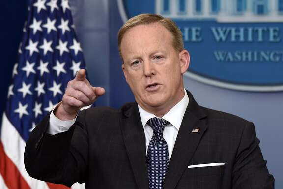 Sean Spicer, White House press secretary, takes a question during a White House press briefing in Washington, D.C., U.S., on Tuesday, May 30, 2017. President�Donald Trump�blasted Germany anew over trade and defense, ratcheting up a dispute with Chancellor�Angela Merkel�that risks getting personal and undermining a trans-Atlantic bond that is the bedrock of U.S.-European relations. Photographer: Olivier Douliery/Bloomberg