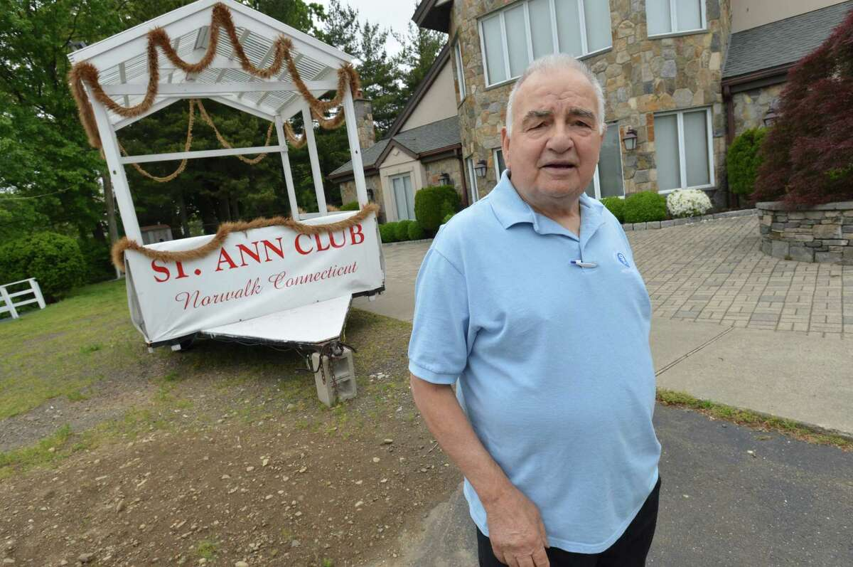 St. Ann Club President Nicandro Cappuccia in front of the clubs float on Tuesday in Norwalk. The float was ready for the Norwalk Memorial Day parade on Monday, but due to bad weather the parade was canceled