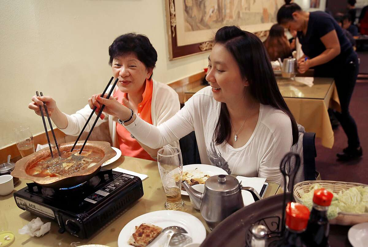 Rebecca Wu (left) from Foster City has a Beijing style lamb hot pot combo with her daughter Nicole Wu (right) at Boiling Beijing on Friday, May 26, 2017, in San Bruno, Calif.