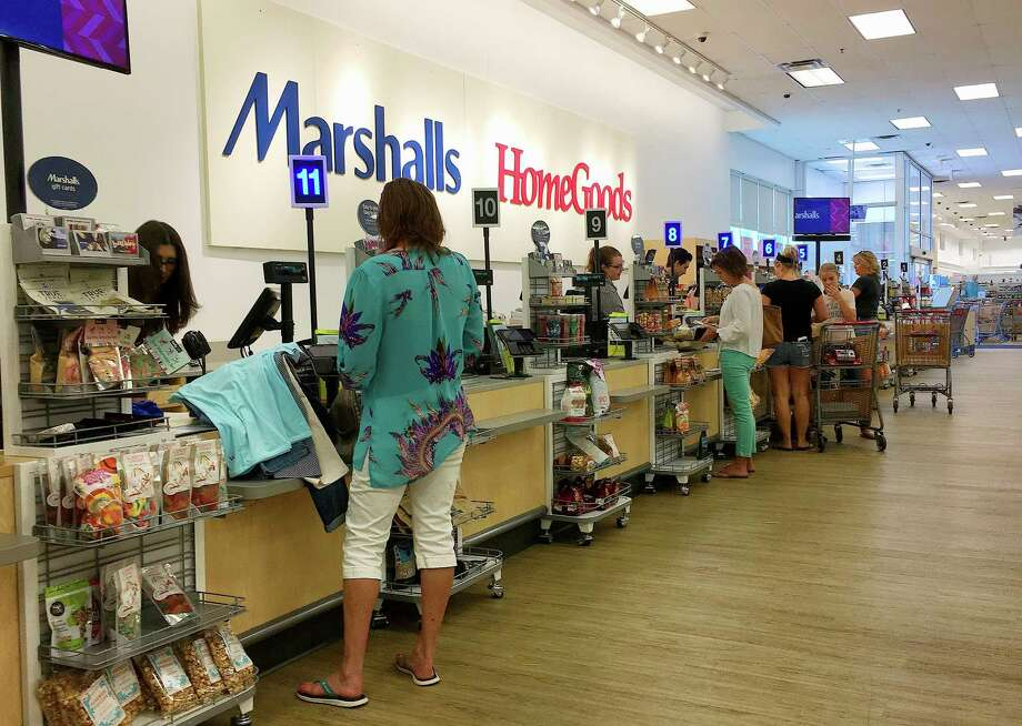 In this Monday, May 15, 2017, photo, shoppers pay for their purchases at a Marshalls & Home Goods retail store, part of the TJX Companies brand, in Phoenix. Americans increased their spending in April at the fastest pace in four months, bolstered by a solid gain in incomes, according to information released Tuesday, May 30, 2017, by the Commerce Department. The strong results underscored expectations that the economy is poised to rebound after a lackluster start to the year. (AP Photo/Ross D. Franklin) Photo: Ross D. Franklin, STF / Copyright 2017 The Associated Press. All rights reserved.