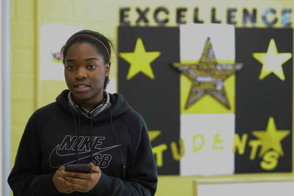 Jones Futures Academy student Khemareah Safu reads a poem about love Monday, April 24, 2017, in Houston. ( Steve Gonzales  / Houston Chronicle )