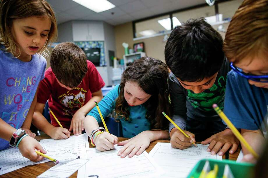 Buckalew Elementary second-graders complete a science worksheet. Photo: Michael Ciaglo, Staff / Michael Ciaglo