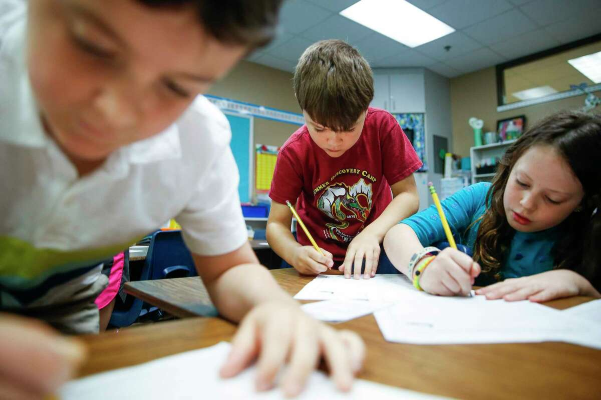 Buckalew Elementary School second graders complete a worksheet in science class Thursday, May 18, 2017 in Conroe. Buckalew Elementary School is the top ranking elementary school in the greater Houston area in the 2017 Children at Risk Annual School rankings. ( Michael Ciaglo / Houston Chronicle )