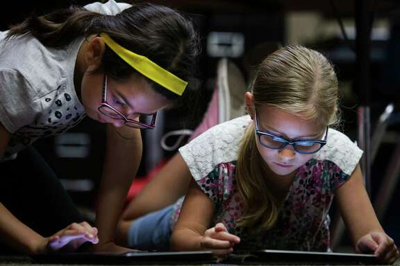 Buckalew Elementary School second graders Amanda McBride, left, and Anna Alexander, right, work on their grammar with an iPad application Thursday, May 18, 2017 in Conroe. Buckalew Elementary School is the top ranking elementary school in the greater Houston area in the 2017 Children at Risk Annual School rankings. ( Michael Ciaglo / Houston Chronicle )