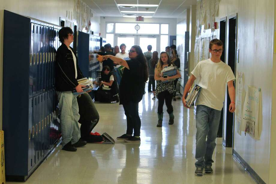 Crenshaw Elementary and Middle School students pass through the hall Friday, May 5, 2017, in Crystal Beach. ( Steve Gonzales  / Houston Chronicle ) Photo: Steve Gonzales, Staff / © 2017 Houston Chronicle