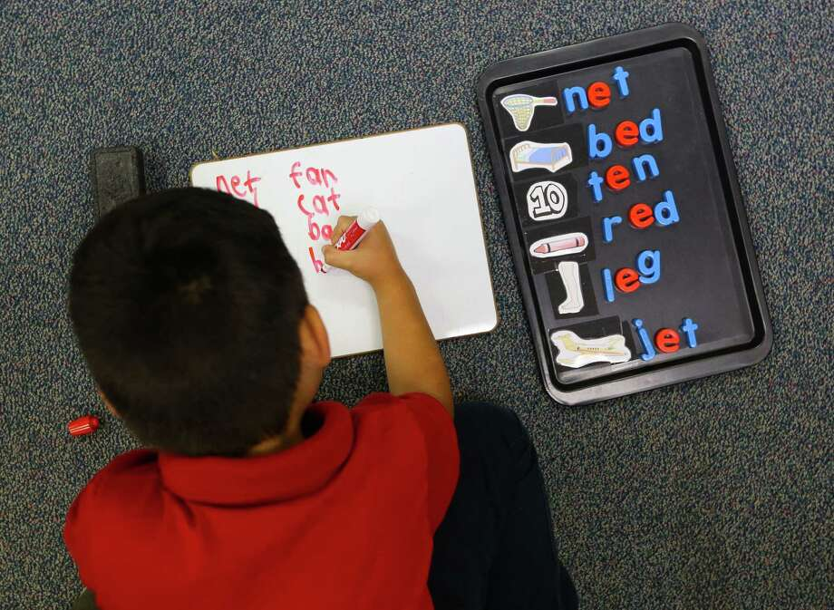 Adrian Navarro-Rincon works on his spelling and in his kindergarten class at Cage Elementary School, Wednesday, April 26, 2017, in Houston. (Mark Mulligan / Houston Chronicle) Photo: Mark Mulligan, Staff Photographer / 2017 Mark Mulligan / Houston Chronicle