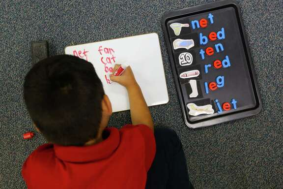 Adrian Navarro-Rincon works on his spelling and in his kindergarten class at Cage Elementary School, Wednesday, April 26, 2017, in Houston. (Mark Mulligan / Houston Chronicle)
