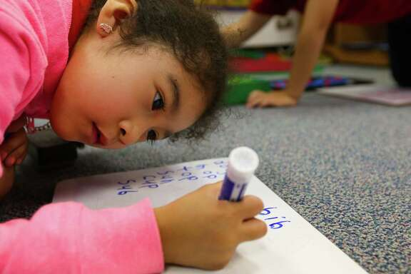 Frida Rocha Baltazar works on her spelling and writing in her kindergarten class at Cage Elementary School, Wednesday, April 26, 2017, in Houston. (Mark Mulligan / Houston Chronicle)