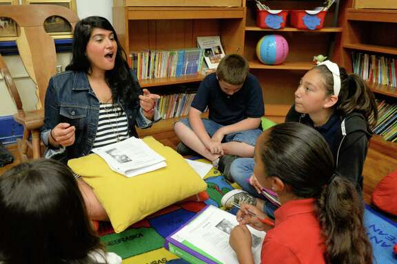 Third-grade reading and language arts teacher Mary Sayegh leads a class at Field Elementary School.