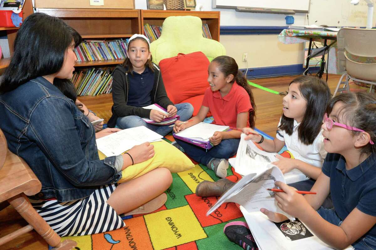 3rd grade reading and language arts teacher Mary Sayegh leads a class at Field Elementary School on April 26, 2017.