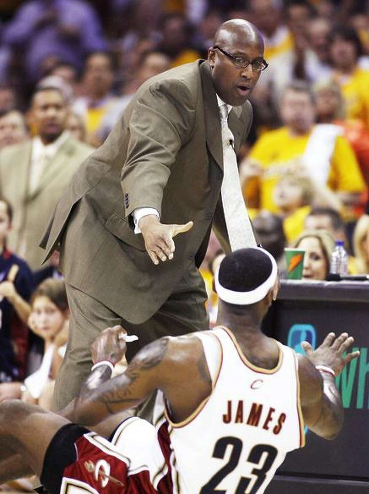 CLEVELAND - APRIL 21: Mike Brown head coach of the Cleveland Cavaliers helps LeBron James #23 off the court while playing the Washington Wizards in Game Two of the Eastern Conference Quarterfinals during the 2008 NBA Playoffs at Quicken Loans Arena on April 21, 2008 in Cleveland, Ohio. Cleveland won the game 116-86. NOTE TO USER: User expressly acknowledges and agrees that, by downloading and or using this photograph, User is consenting to the terms and conditions of the Getty Images License Agreement. (Photo by Gregory Shamus/Getty Images)
