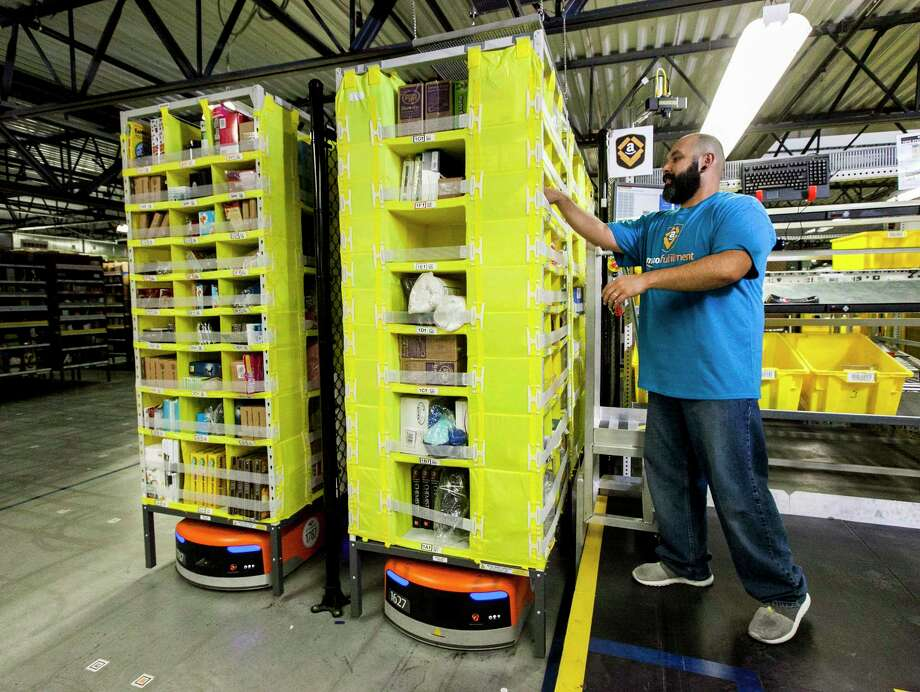 Amazoné•s first large-scale fulfillment center in Houston will include robots that quickly fetch inventory for warehouse workers tasked with packing and shipping. Photo: Photographer: Eric Slomanson / (c) 2014 Eric Slomanson. All Rights Reserved.