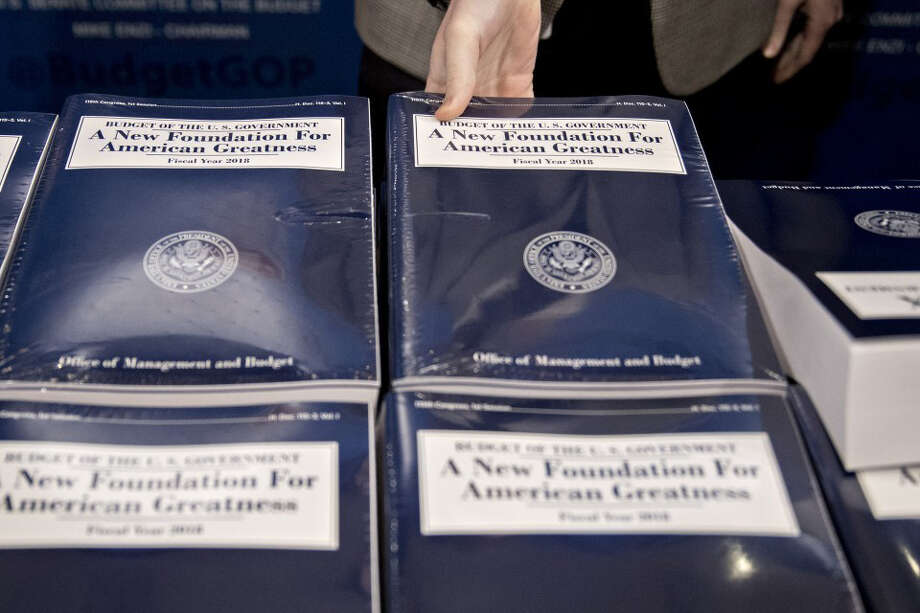 A copy of President Donald Trump's fiscal 2018 budget proposal. Funding for Medicaid would be cut by more than $800 billion over 10 years.(Bloomberg photo by Andrew Harrer) Photo: BLOOMBERG / Stratford Booster Club