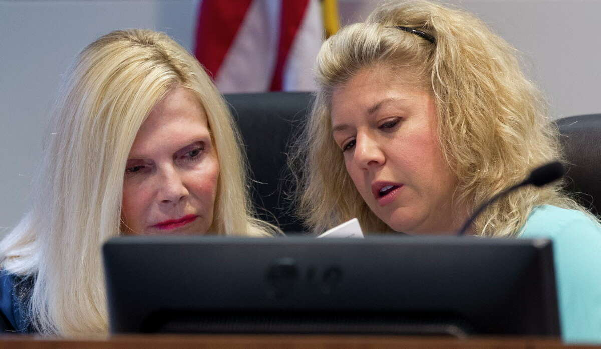 Ann Snyder, left, and Laura Fillault with The Woodlands Township Board of Directos are seen during a meeting, Thursday, April 26, 2017, in The Woodlands.