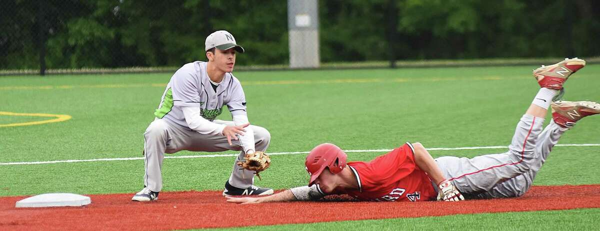 Norwalk second baseman Kyle Mossop, left, waits to put the tag on Conard baserunner Jeff LaRosa on a stolen baseball attempt in Tuesday's CIAC Class LL baseball tournament game at Norwalk. LaRosa was called safe on the play, but the call was nullified after the batter was ruled striking out for the third inning.