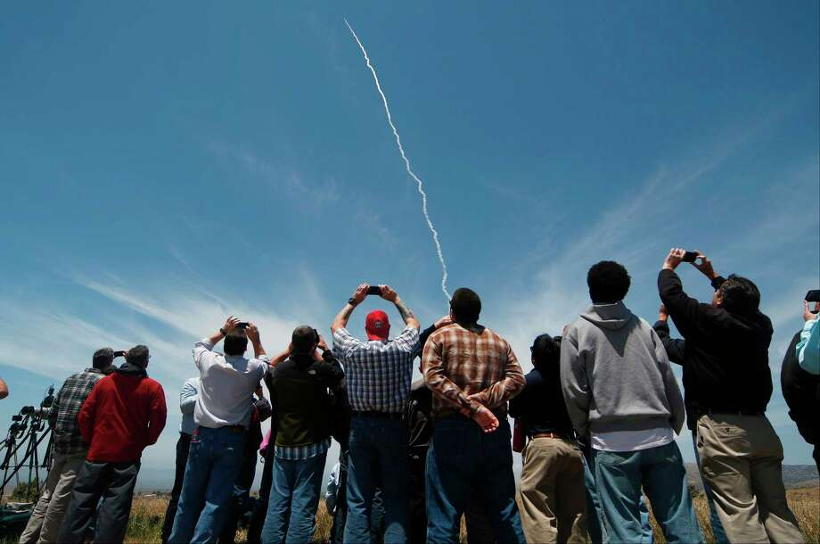 People watch a ground-based interceptor missle take off at Vandenberg Air Force base, California, on Tuesday in a test of U.S. defense capabilities against a nuclear warhead launched from North Korea.  Photo: GENE BLEVINS, Stringer / AFP or licensors