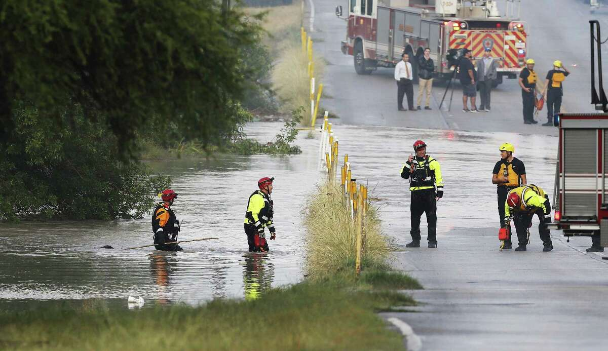 SAFD's Technical Rescue personnel come out from Leon Creek off Military Road during a search for reported missing individuals who may have been caught up in high water after a storm blew through the city on Tuesday, May 30, 2017. (Kin Man Hui/San Antonio Express-News)
