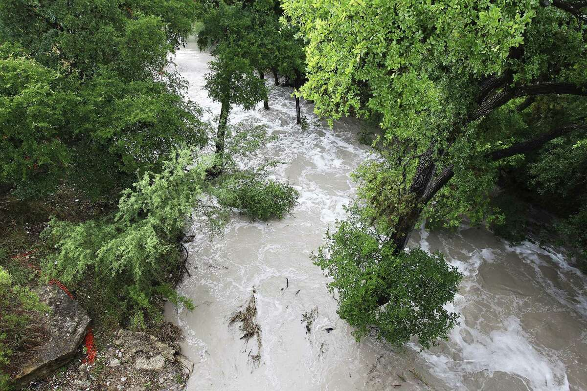 Portions of Huebner Creek near Ingram and Northwestern overflows with water as SAFD's Technical Rescue personnel conduct a search for reported missing individuals who may have been caught up in high water after a storm blew through the city on Tuesday, May 30, 2017. (Kin Man Hui/San Antonio Express-News)