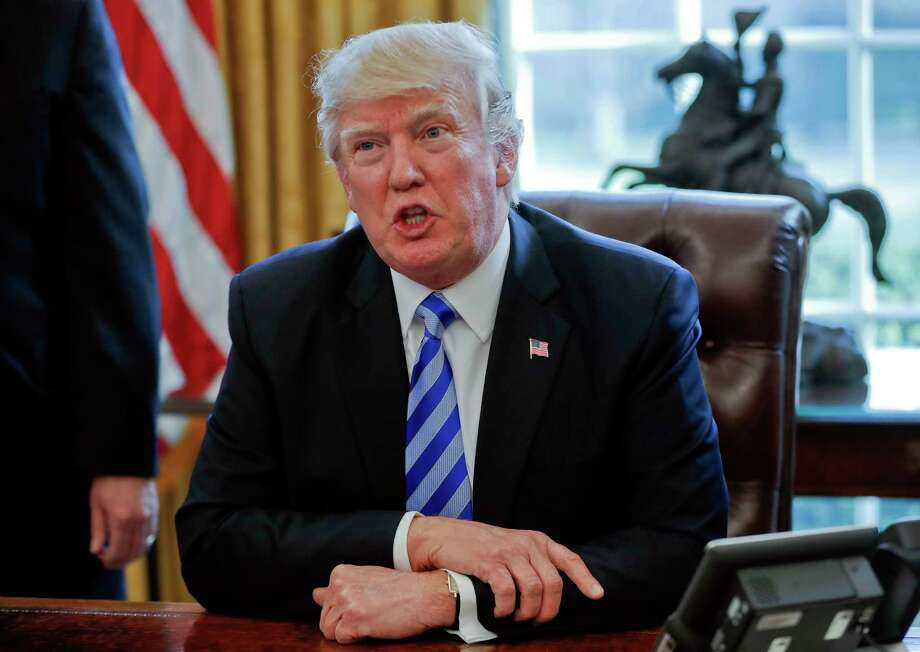 FILE - In this March 24, 2017, file photo President Donald Trump speaksin the Oval Office of the White House in Washington. Trump has been handing out his cellphone number to world leaders and urging them to call him directly, an unusual invitation that breaks diplomatic protocol and is raising concerns about the security and secrecy of the U.S. commander in chief's communications. (AP Photo/Pablo Martinez Monsivais, File) Photo: Pablo Martinez Monsivais, STF / Copyright 2017 The Associated Press. All rights reserved.