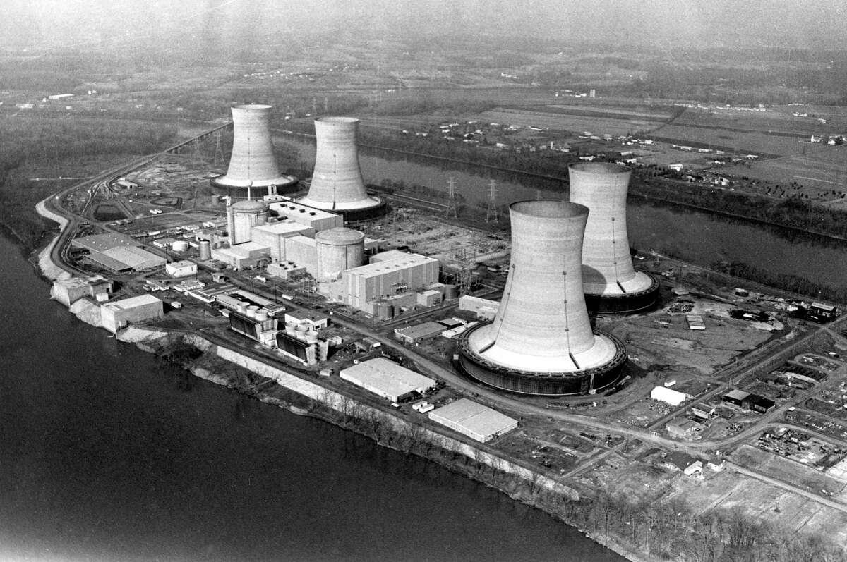 FILE - This March 30, 1979, file photo shows an aerial view of the Three Mile Island nuclear power plant near Harrisburg, Pa. Exelon Corp., the owner of Three Mile Island, site of the United States' worst commercial nuclear power accident, said Monday, May 29, 2017 it will shut down the plant in 2019 without a financial rescue from Pennsylvania. (AP Photo/Barry Thumma, File)