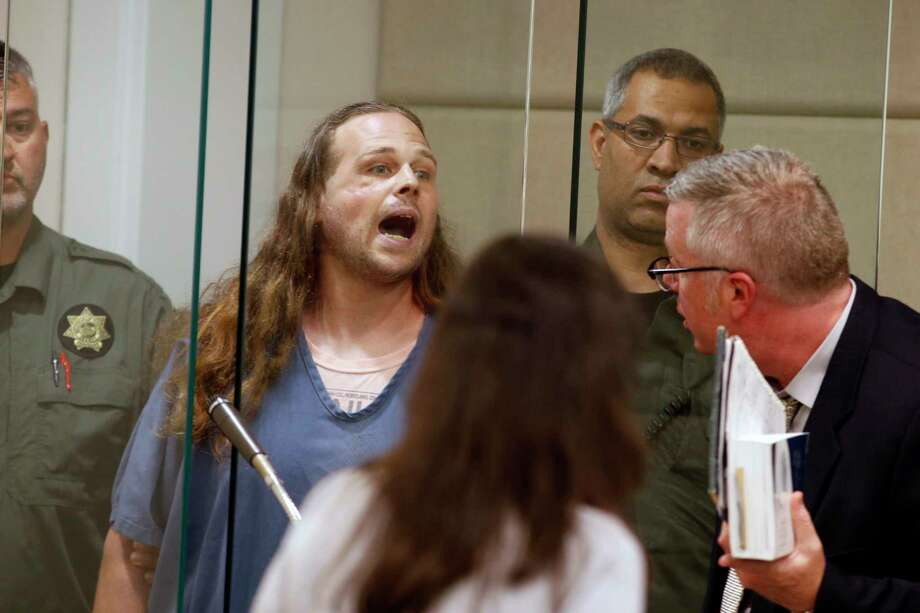 Jeremy Joseph Christian, center, is arraigned for attacking two men and wounding another after they defended two Muslim women Christian was verbally abusing. Photo: Beth Nakamura, POOL / Pool The Oregonian