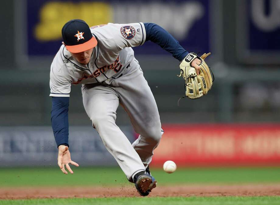 Alex Bregman adds a slick defensive play to a strong all-around game Tuesday night, retiring the Twins' Brian Dozier in the second inning. At the plate, Bregman had a sacrifice fly in the third and a home run in the seventh. Photo: Hannah Foslien, Stringer / 2017 Getty Images