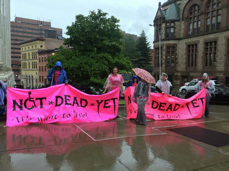 Members of the disability rights group Not Dead Yet demonstrated outside the New York Court of Appeals on Tuesday, May 30, as judges heard arguments about aid in dying. (Claire Hughes / Times Union)