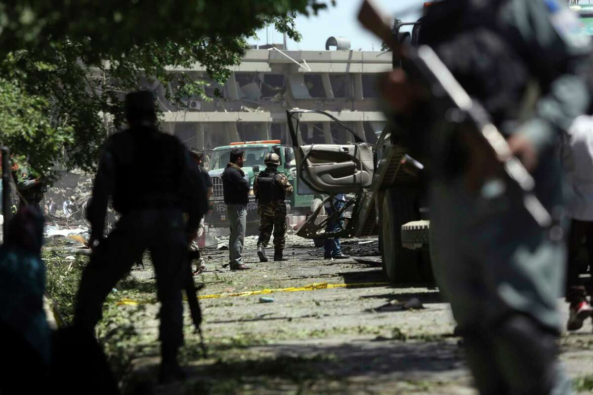 Security forces inspect near the site of a suicide attack where the German Embassy is located in Kabul, Afghanistan, Wednesday, May 31, 2017. A massive explosion rocked a highly secure diplomatic area of Kabul on Wednesday morning, causing casualties and sending a huge plume of smoke over the Afghan capital.