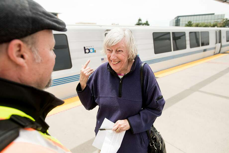 Anita Ogden smiles while listening to station announcements through a hearing loop system at BART's Fremont station on Tuesday, May 30, 2017, in Fremont, Calif. Ogden said it's been a long time since she was able to hear the announcements. Photo: Noah Berger, Special To The Chronicle