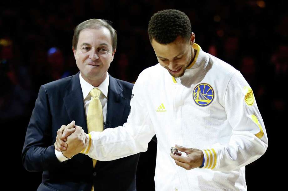 OAKLAND, CA - OCTOBER 27:  Stephen Curry #30 of the Golden State Warriors receives his championship ring from owner Joe Lacob prior to their game against the New Orleans Pelicans during the NBA season opener at ORACLE Arena on October 27, 2015 in Oakland, California. NOTE TO USER: User expressly acknowledges and agrees that, by downloading and or using this photograph, User is consenting to the terms and conditions of the Getty Images License Agreement.  (Photo by Ezra Shaw/Getty Images) Photo: Ezra Shaw / Getty Images / 2015 Getty Images