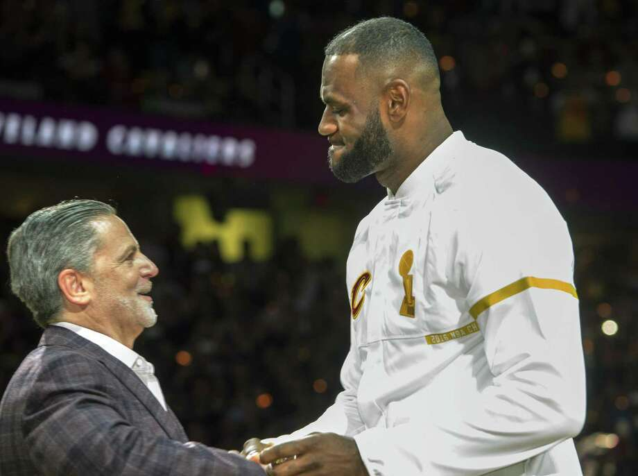 Cleveland Cavaliers' LeBron James accepts his NBA championship ring from Cavaliers owner Dan Gilbert before a basketball game against the New York Knicks in Cleveland, Tuesday, Oct. 25, 2016. (AP Photo/Phil Long) Photo: Phil Long / AP / FR53611 AP
