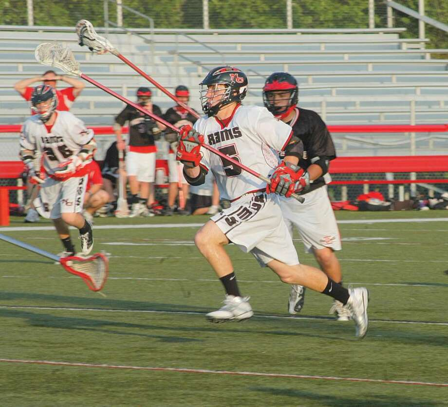 Joe Costigan charges toward the goal during last week's state tournament opener at home against Pomperaug. Photo: Andy Hutchison / For The New Canaan News, Contributed Photo / New Canaan News