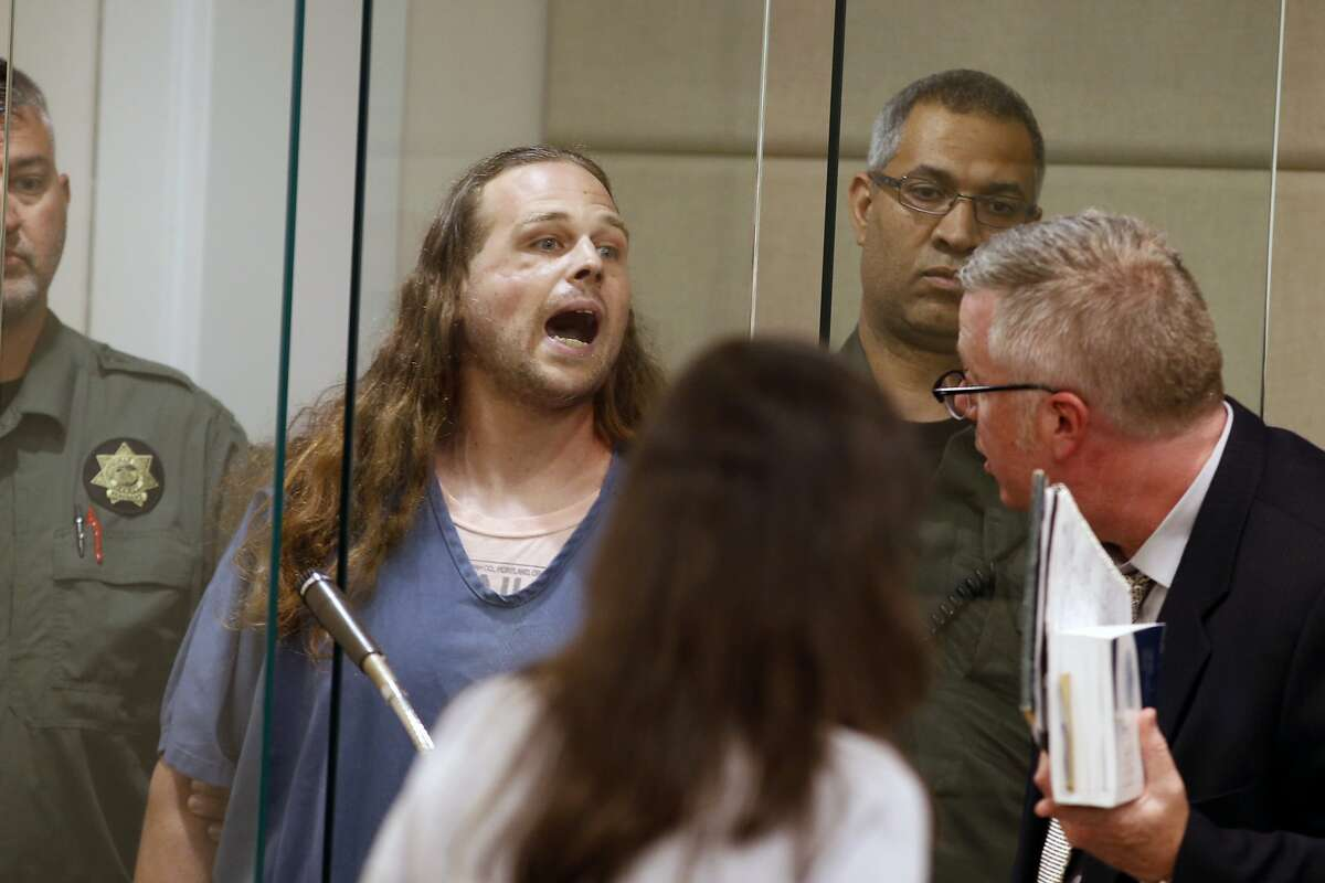 Jeremy Joseph Christian shouts as he is arraigned in Multnomah County Circuit Court in Portland, Ore., Tuesday, May 30, 2017. Authorities say Christian started verbally abusing two young women, including one wearing a hijab. When three men on the train intervened, police say, Christian attacked them, killing two and wounding one. (Beth Nakamura/The Oregonian via AP, Pool)